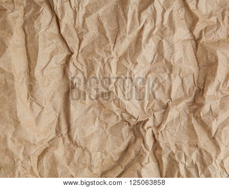 crumpled cream color tone paper pattern texture background in sepia light.bright creased plain backdrop concept.vintage scruffy disheveled wallpaper conception.empty edge parchment paper sheet wall.