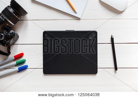 Concept Of The Artist Desktop. Graphics Tablet, Slr Camera, Mouse, Notebook, Pencil And Markers On A
