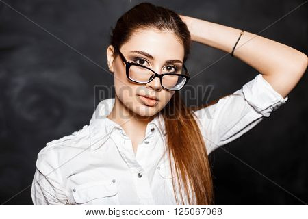Fashionable Young Professional Woman In Glasses And A White Blouse.