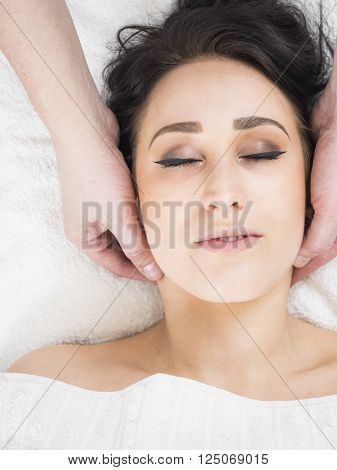 Young lady at massage parlor having a treatment