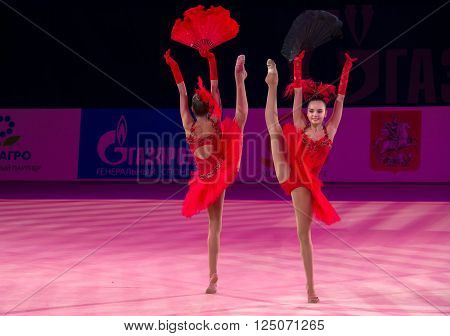 MOSCOW, RUSSIA - FEBRUARY 21, 2016: Rhythmic gymnasts Dina and Arina Averina, Russia at the gala concert Grand Prix Moscow - 2016 in Moscow sport palace Luzhniki, Russia
