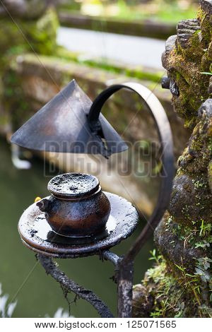 Burning oil lamp in Pura Saraswati Temple. Ubud, Bali, Indonesia.