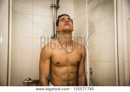 Close up Attractive Young Bare Muscular Young Man Taking Shower, Looking Down
