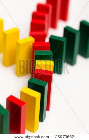 colorful dominos on white background coming together concept connection or global networking vertical