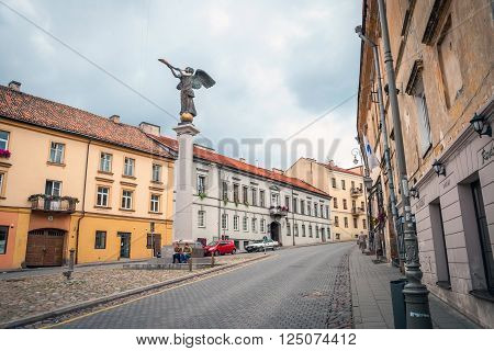 VILNIUS LITHUANIA - JULY 12: View on historic angel statue blowing in horn against of cloudy sky in Vilnius june 2015