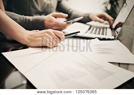 Business situation, team work, brainstorming.Photo account manager working modern office with new business project.Using laptop, discussion startup, colsultation.Horizontal.Blurred