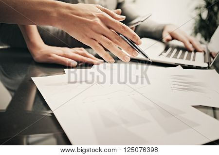 Business situation, team work, brainstorming.Photo account manager working modern office with new business project.Using laptop, discussion startup, colsultation colleague.Horizontal.Blurred