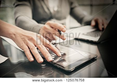 Finance department working process.Photo woman showing business reports modern tablet. Banker holding pen for signs documents, discussion startup idea.Horizontal.