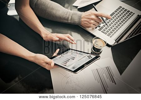 Finance department working process.Photo woman showing business reports modern tablet, diagram screen. Banker manager using laptop, discussion startup idea.Horizontal.