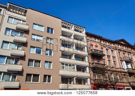 Facades of modern residential building and old building in Poznan