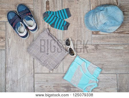 Flat lay photography of male casual outfit. Male casual outfit on wood board background