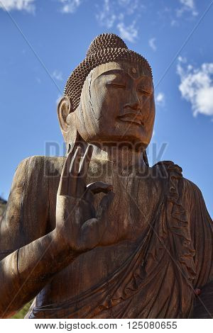 wooden figure of buddha in quiet meditation