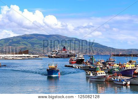 PONTA DELGADA, AZORES, PORTUGAL - SEPTEMBER 29, 2015: Fishing boats and ships in the harbor of Ponta Delgada on Sao Miguel island, Azores