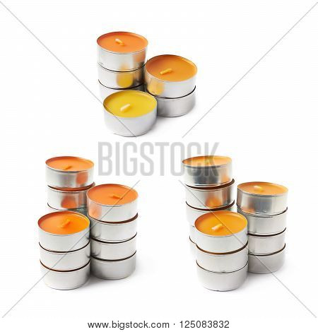Stack of tealight paraffin wax orange candles isolated over the white background, set of three different foreshortenings