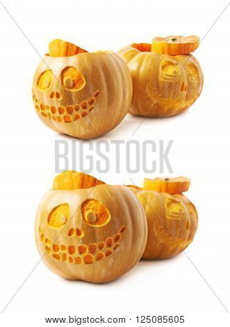 Two Jack-O-Lantern pumpkins, composition isolated over the white background, set of two different foreshortenings