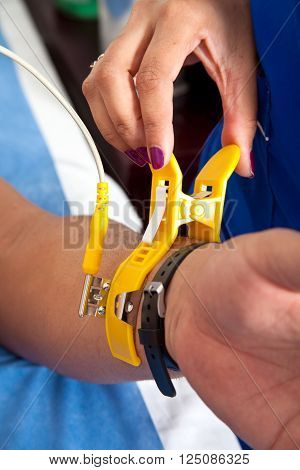 Placing an electrode clip on patient wrist