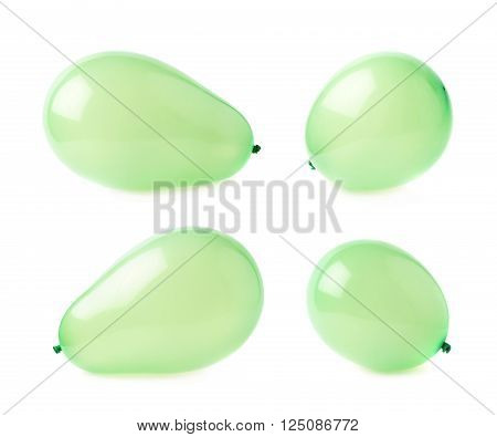 Inflated green air balloons isolated over the white background, set collection of four different foreshortenings