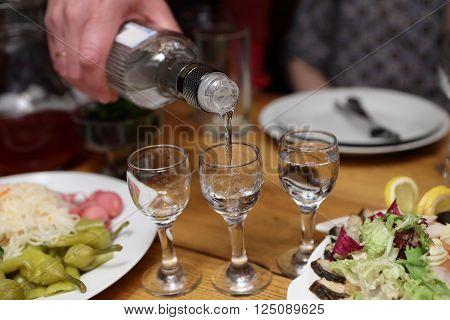 Person Filling Vodka