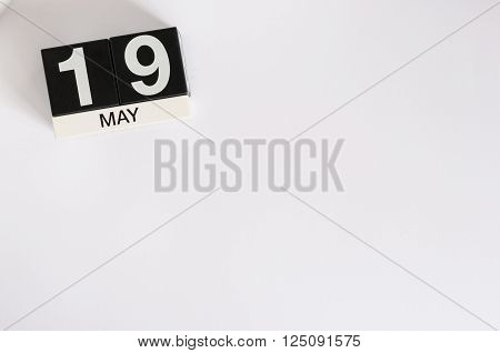 May 19th. Image of may 19 wooden color calendar on white background.  Spring day, empty space for text.