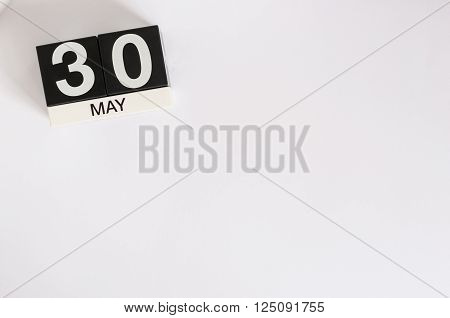 May 30th. Image of may 30 wooden color calendar on white background.  Spring day, empty space for text.