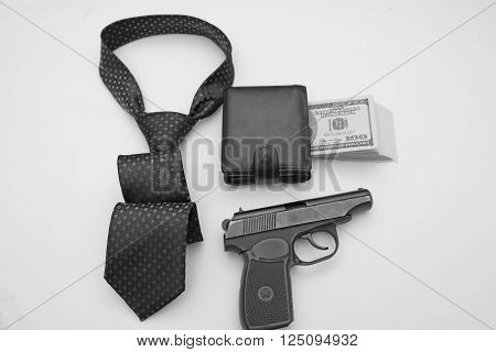 composition of objects as a purse full of bills tie semiautomatic weapons.