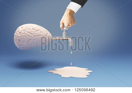 Brain drain concept with businessman hand on tap coming out of abstract brain on blue background. 3D Rendering