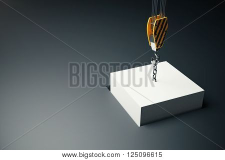 White block hanging on crane hook going into hole on dark background. 3D Rendering