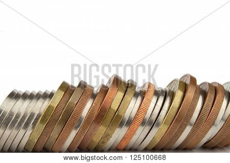 The concept of saving. Coins stacked on each other. Valid Czech coins on a white background.