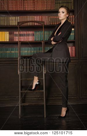 Confident Business Woman In The Classical Library