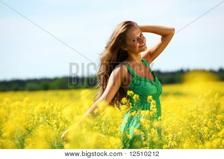 woman on oilseed field