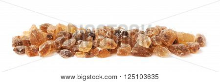 Line made of multiple large brown rock sugar crystals isolated over the white background