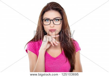 Studio shot of beautiful young brunette woman. Pretty girl with glasses looking at camera. Isolated background