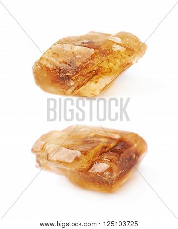 Single large brown rock sugar crystal isolated over the white background, set of two different foreshortenings