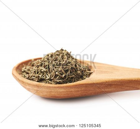 Spoon full of dried thyme seasoning isolated over the white background, close-up crop fragment