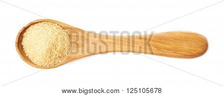 Wooden spoon full of stevia cane sugar isolated over the white background