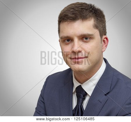 Studio portrait of business man isolated on grey background