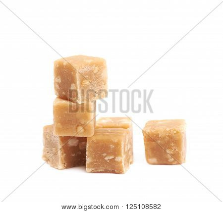 Toffee candy with nuts, composition isolated over the white background