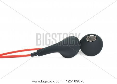 Pair of red headphones isolated over the white background, close-up crop fragment