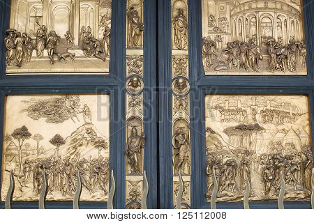 Florence Italy-May 31 2015. Close up detail of the gilded bronze doors of the Florence Baptistery. The doors were created by Lorenzo Ghiberti and are known as the Gates of Paradise
