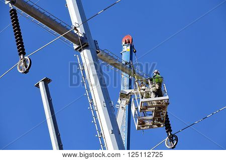 Electric high voltage transmission tower utility workers on April 8, 2016 in Prescott, Arizona, USA.