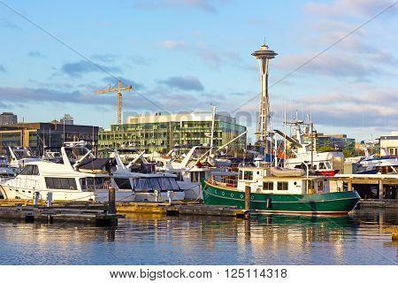A view on Seattle Space Needle from the waters of Lake Union. A morning in Seattle downtown in the morning with yachts reflections in the lake.