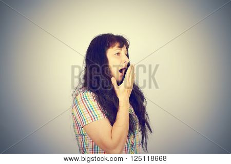 Tired Young Brunette Girl Yawns.