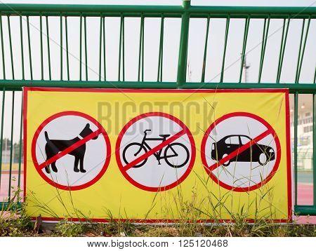 No dogs allowed sign in running, No bikes, No Car in the running