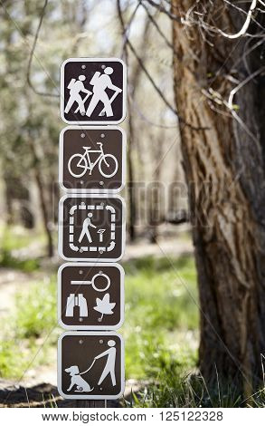 recreation use sign on walking hiking trail in forest