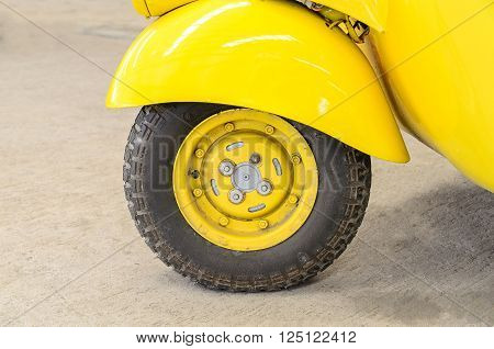 Vintage Yellow Car Wheel; Classic Vehicles. Old car.