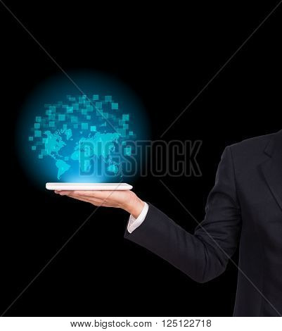 Businessman holding a tablet with map world on black background