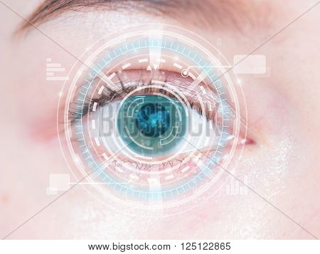 Close-up of woman's blue eye. High technology in the futuristic. scan contact lens