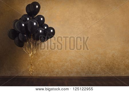 Bunch Of Black Balloons On Gold Background