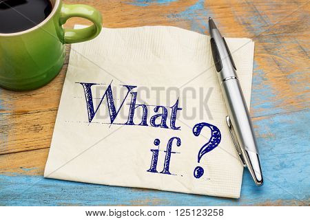 What if question - handwriting on napkin with a cup coffee against grunge painted wood