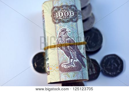 Close up different Dirhams currency note and coins, United Arab Emirates